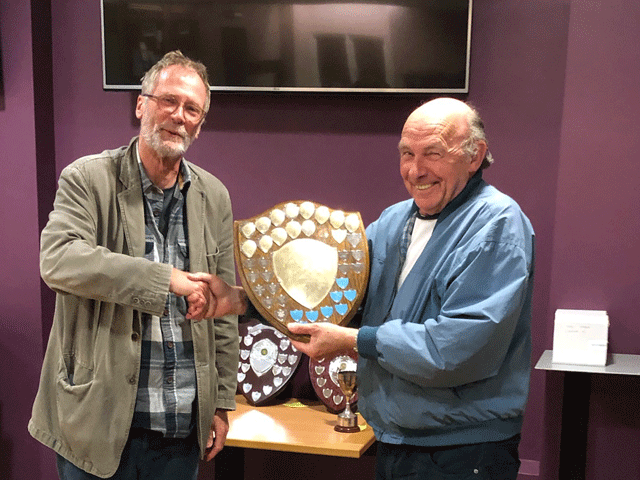 Mike Cuggy presents the Premier Division trophy to Andrew Kinder the Newton Abbot Bishops team captain
